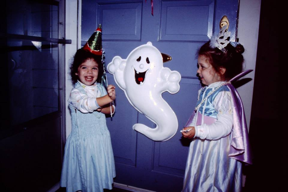 Two girls trick or treat on Halloween in 1992.