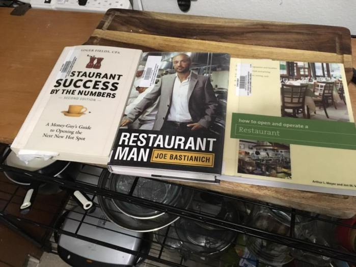 "Three library books, 'Restaurant success by the Numbers,"" ""Restaurant Man,"" and ""how to open and operate a Restaurant."""