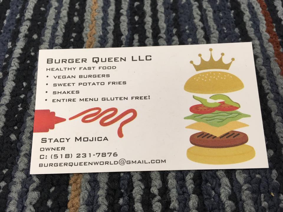 """a business card for a business named """"Burger Queen llc"""" that serves healthy fast food including vegan burgers, sweet potato fries and shakes. a burger with a crown and a bottle of ketchup with a squeeze of ketchup decorate the card."""