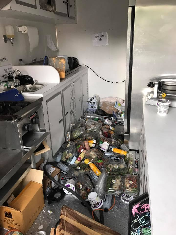 When everything fell out of the refrigerator in the food trailer because we forgot to lock the fridge door, everything was covered in salad. There is a huge mess.