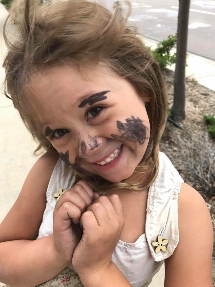 A five year old gave herself some makeup with a sharpie.