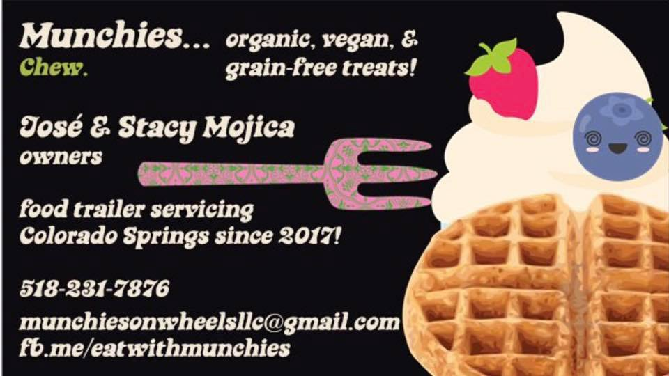 A business card for Munchies, organic, vegan, and grain-free treats. A waffle shortcake and fork are superimposed on a black background.