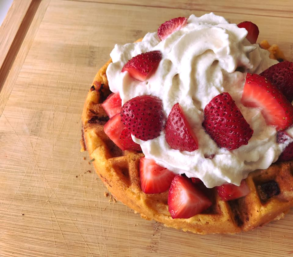 A vegan grain-free strawberry shortcake made on a sweet potato waffle with