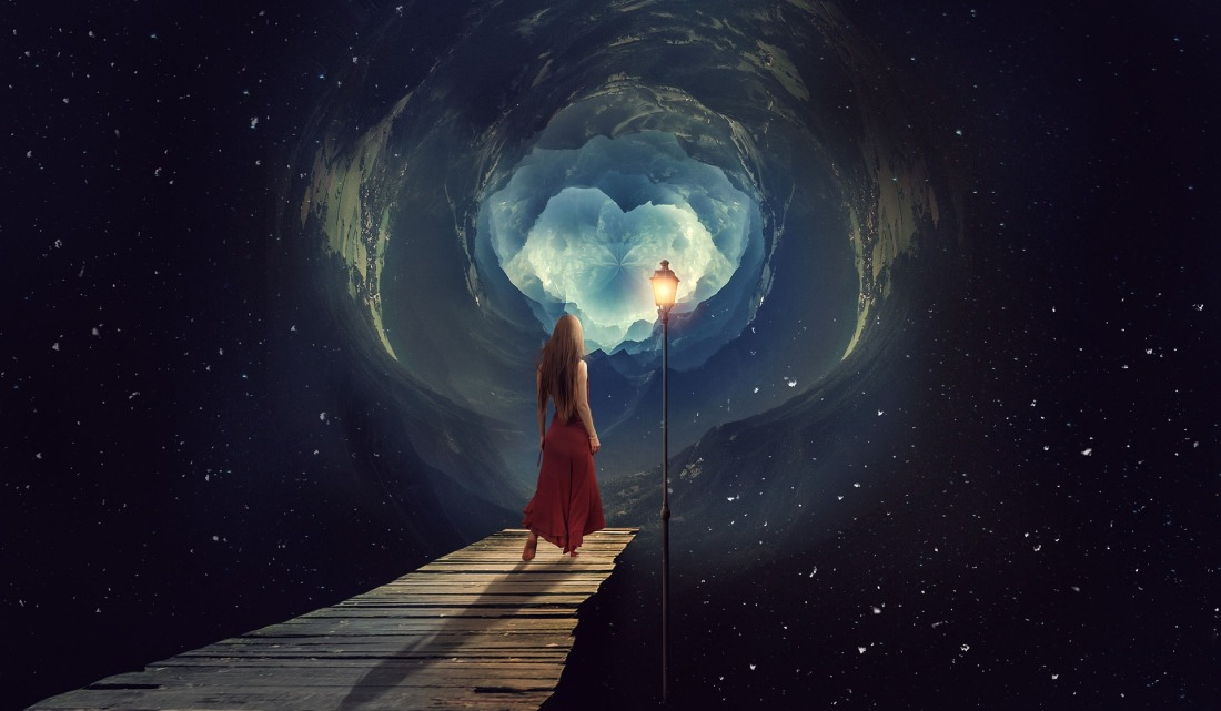 Woman in a red dress walking down a boardwalk in the stars toward a lamppost lighting the way to a glowing hole in the cosmos.