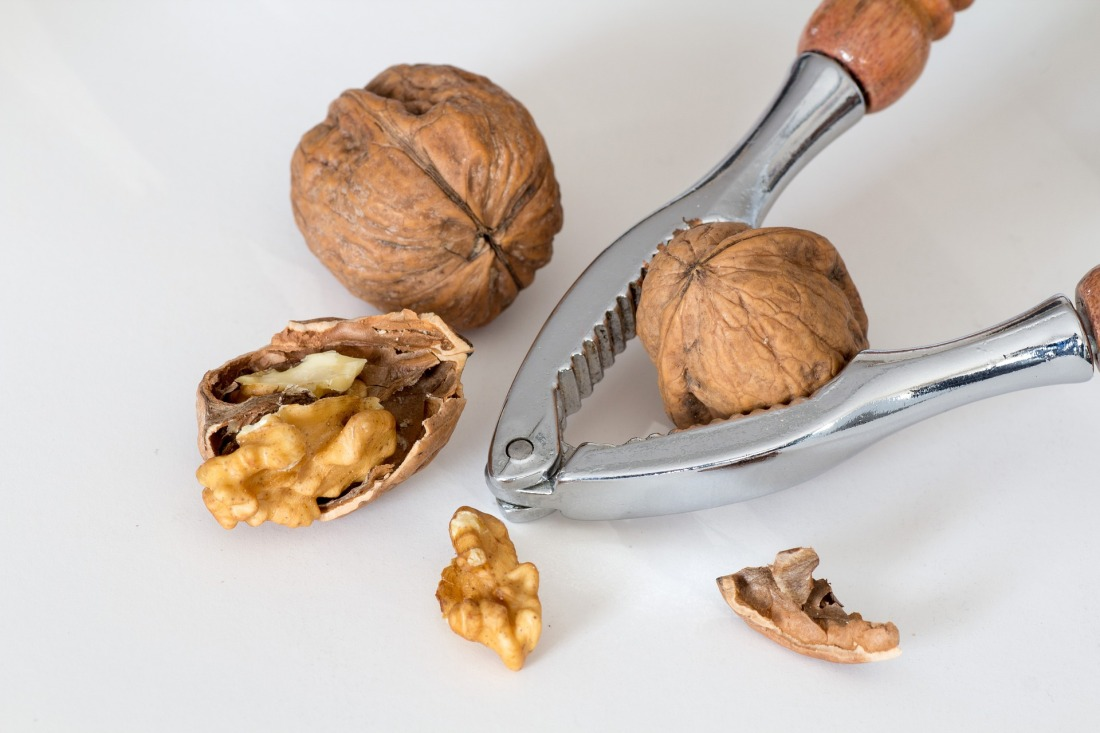 a nutcracker cracking walnuts