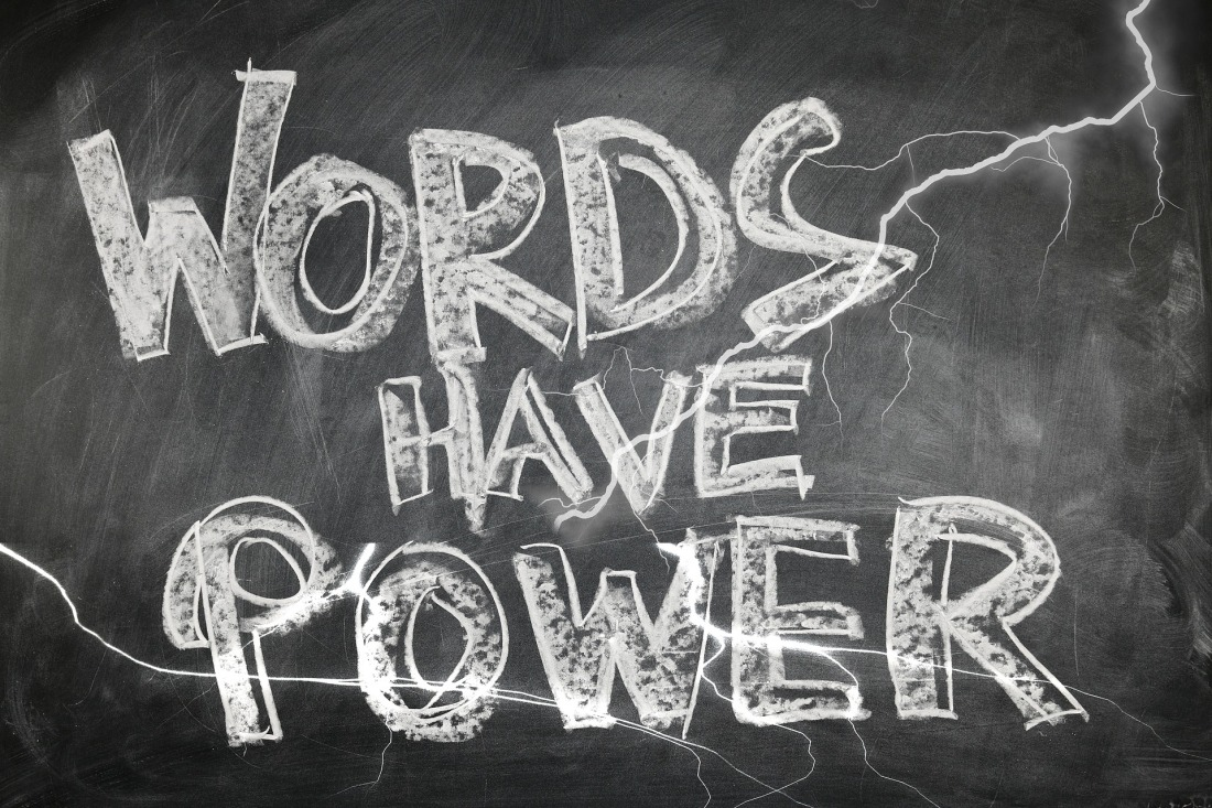 "Chalkboard with that says ""words have power"" written on it surrounded by lightning."