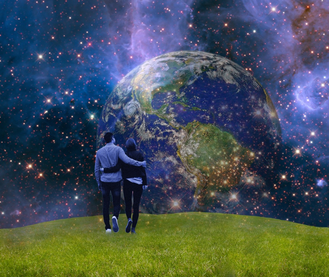 Millennial couple walking in a field with planet earth and the cosmos hovering around them