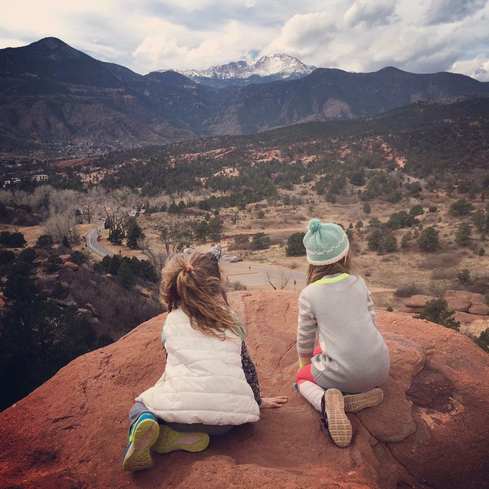 two girls in Colorado Springs' Garden of the Gods looking at Pikes Peak