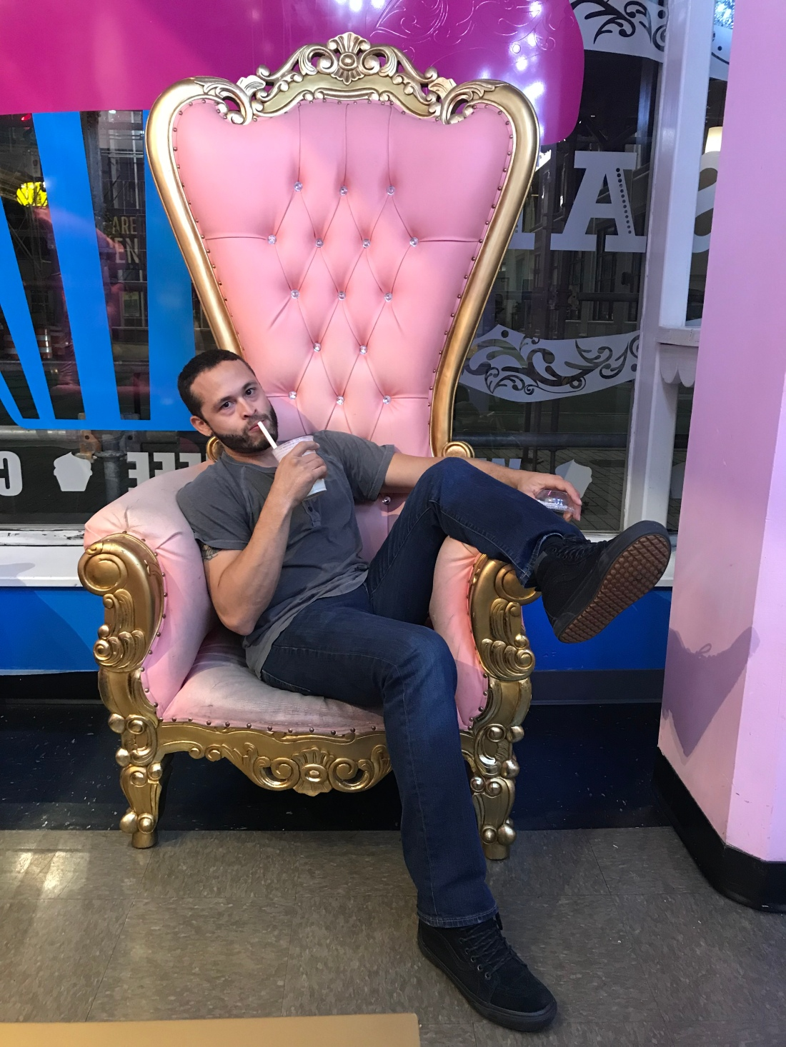 man in pink chair