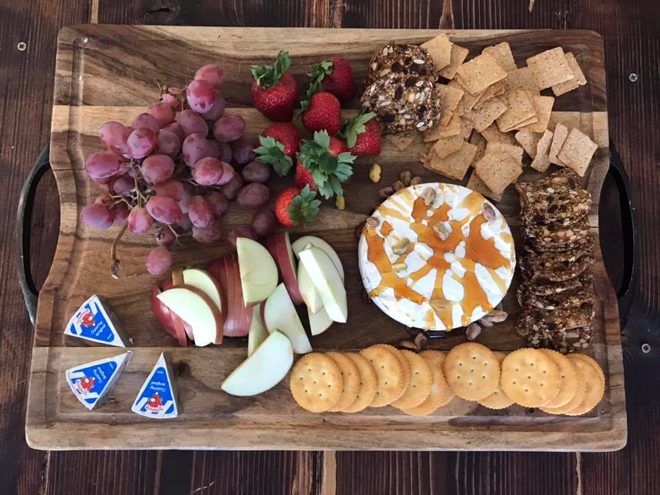 snack tray with brie and grapes
